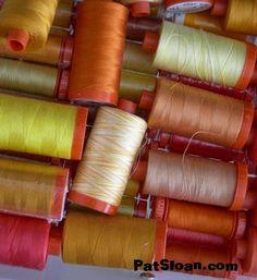 my orange and yellow drawer of Aurifil thread                  LOVE LOVE LOVE This thread