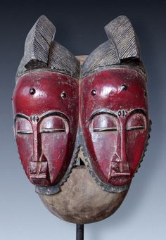 Africa | Twin faced mask from the Baule people of the Ivory Coast | Wood with pigment