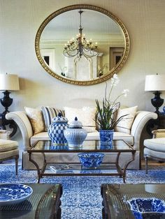 White with cobalt blue/white china, couch, mirror.