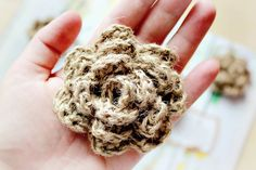 crocheted-twine-flower. Would look great with burlap.