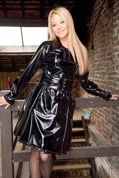 Black PVC Raincoat an a blond Ausie cute