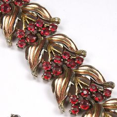Trifari 'Alfred Philippe' Gold Leaves and Ruby Flowers Link Bracelet /  Mark, design, construction, and non-use of Sterling date this to 1938-42 /465