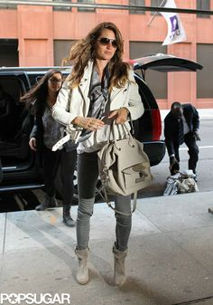 The Best Model-Off-Duty Looks (Updated!): Gisele Bundchen layered up in a white leather jacket, a silk scarf, gray skinny jeans, and gray suede boots in NYC. Models Off Duty, Star Fashion, High Fashion, Street Fashion, Street Chic, Black Leather Bomber Jacket, Leather Jackets, Leather Coats, Grey Skinny Jeans
