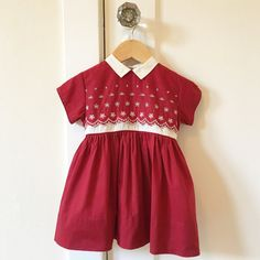 Vintage 1960s burgundy Nanette Dress for toddler girl.  D E T A I L S  Petite ivory flat collar Ivory floral eyelet on bodice Scallop trim eyelet overlay on top of an inset ivory waist at bodice Piped sleeves Unlined Sash & buttons in back for dressing 3 inch high hem  E R A  Estimated to be from the 1960s, tag reads Nanette, Made in USA, RN 14701  F A B R I C A T I O N Feels like a cotton poplin or lightweight broadcloth  C A R E Machine wash gentle cycle + hang dry  C O N D I T I O N…