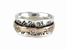 """Inside ring in sterling silver. Outside ring in 14k rose gold with 2.25mm brilliant cut diamond. The spin ring has the words """"love"""" - """"prem"""" written in sanskrit and """"peace"""" - """"shanti"""" written in sanskrit. $1,250.00 created by www.sonjapicard.com"""