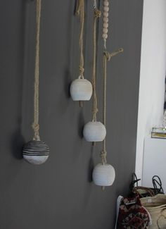 Above: Hand-thrown stone bells on hemp rope made by Michelle Quan; prices range from $135 to $195, depending on size.