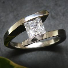 Brilliant princess cut diamond in custom tension setting - so simple yet regal in a very contemporary way...