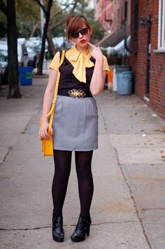 Three cheers for yellow!  Plus, she made this outfit by tucking in her little black dress to the plaid skirt.