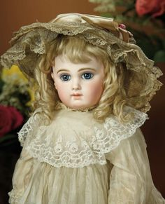 Bread and Roses - Auction - July 26, 2016: 194 Beautiful French Bisque Portrait Bebe by Emile Jumeau with Toy Poupard