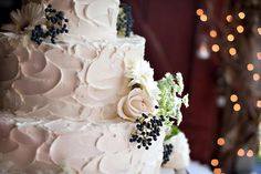 white homemade style wedding cake with flowers