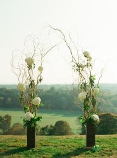Talk floral and branch arrangements make for a chic wedding arch