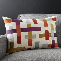 Like structural beams, this intriguing pattern constructs a carefully balanced composition of embroidered bars on natural cotton flax, bringing to mind the great look of classic, graphic mid-century geometry.  Pillow reverses to solid natural cotton flax. Our decorative pillows include your choice of a plush feather-down or lofty down-alternative insert at no extra cost.<br /><br /><NEWTAG/><ul><li>68% rayon and 32% linen with 100% acrylic embroidery</li><li>On-seam…