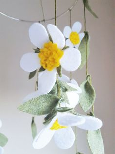 ♥ Original wildflower mobile includes: - 13 white wildflowers  - 6 yellow buds  - 30 olive green leaves  ♥ Each flower and leaf is made of eco-friendly felt and hung with olive green embroidery thread from a steel ring 8 in diameter  ♥ Hangs approximately 18 (46cm) from a 1 diameter metal ring  (Length of mobile may vary slightly)   == WANT DIFFERENT COLORS? ==  Get this beautiful mobile in any combination of colors you want! Send me a message at purchase with your ideas ...