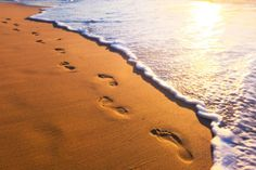 Beach, Wave And Footsteps At Sunset Time Fotoprint