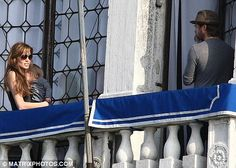 Angelina Jolie and Brad Pitt hold their twins in Venice following his return from London for the premiere of Kick-Ass