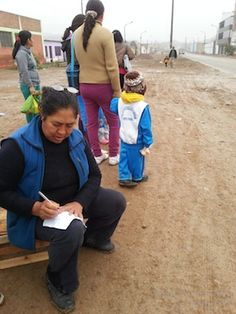 Feeding the Masses in Puente Piedra - Antonia making the list to feed 50 for a week!