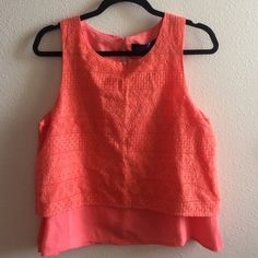 Coral lace detailed tank NWT Brand new! This is a Feancesca's tank top with lace detailing. It is so perfect for the spring and summer. This would look adorable with some dark jeans and nude heels or sandals. Francesca's Collections Tops Blouses