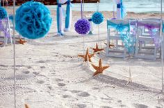 Lilac and turquoise pomanders line the aisle