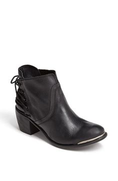 Free shipping and returns on SIXTYSEVEN 'Blake' Bootie at Nordstrom.com. A corset-like lace-up detail in back defines a fabulous leather bootie styled with an overlapping collar and silvertone trim at the toe.