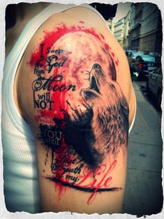 Trash design tattoo, with typography and a wolf howling to the moon.