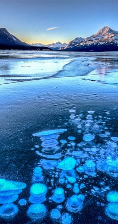 This unique lake Abraham in Alberta, Canada, has cool-looking bubbles frozen near the surface. Click through to see 20 more UNREAL travel destinations!