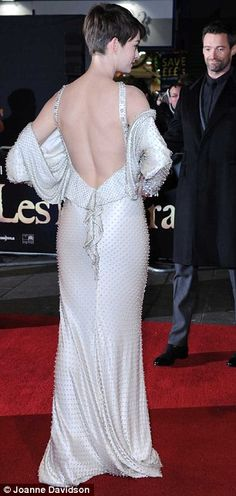 Plenty of drama: The floor-length gown was backless and boasted symmetrical beading covering the entire outfit