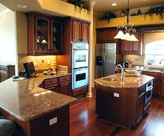Warm and Inviting Kitchen.  This would be part of my dream home because the cabinet color, floor and counter tops.  Very warm