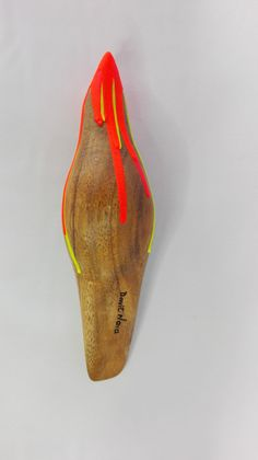 Pink-Yellow Melting Birdie This environmentally-friendly and colorful birdie is made out of post-natural disaster wood, i.e. wood collected after a