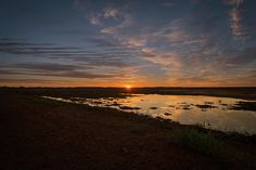 Early morning reflections in a big puddle after some welcome rain in the drought-affected Channel Country in Queensland. #australia #outback #puddle #sunrise