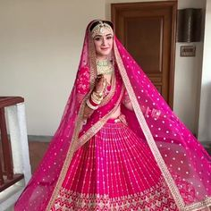 Look gorgeous in this pink colored bridal lehenga in velvet decked with intricate zardosi embroidery, sequins and stone work all over. Indian Bridesmaid Dresses, Indian Wedding Gowns, Indian Bridal Outfits, Indian Gowns Dresses, Indian Bridal Fashion, Bride Indian, Designer Bridal Lehenga, Wedding Lehenga Designs, Bridal Lehenga Choli