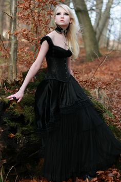 Who is this lovely and mysterious looking girl we see on so many pins, boards and blog posts?  And, notice how black Gothic garb often looks doubly nice amidst Autumn hues...why is that?