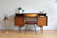 Midcentury modern Mainline Desk by Hooker. Double pedestal desk with file cabinet drawer.  Finished backside! Floating top with gorgeous walnut woodgrain.  Metal hardware. Minor vintage wear. ...