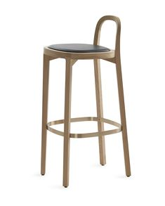Woodnotes Siro+ bar stool, oak and finished with a polished wax, brass footrest, seating height 75 cm, leather upholstered seat.  The Siro+ barstool was one of the 2018 winners in the German Design Award's Excellent Product Design category. The honour is handed out by the German Design Council, a leading competence centre for design promotion.