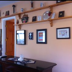 Wall to wall shelving with plaques, awards, etc. over a bar... Man cave ideas. I should just start a board for the hubby.