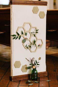 Geometric aisle decor for a wedding ceremony.