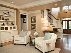 Family Room for Five | Rebecca Driggs | HGTV  Accent wall with grass cloth beige walls white trim
