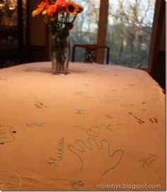 Embroidered guest tablecloth - they sign, you embroider. Genius. From Made by K. I love this and have started this for every party we host. This year we will have our kids sign it. Very cool. Something they will always remember....this seems like a great idea for a family reunion or 50th anniversary event
