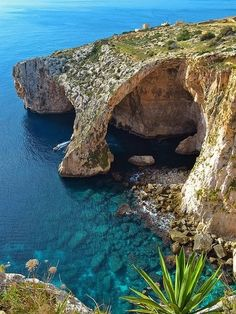 "The Blue Grotto, Malta. ""On the southern coast of Malta, west of Wied iz-Zurrieq facing the little deserted islet of Filfla. The site got its name from a British soldier who thought that since the area looks like the Grotta Azzurra in Capri, it deserves the same name, and in fact Blue Grotto is the equivalent for Grotta Azzurra in English."""