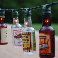 GENIUS! Made with twinkle lights & empty shot bottles! Must be fun emptying the bottles, lol...