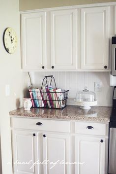 I love the simplicity and feeling of a WHITE kitchen. I adore the old metal basket here, especially.
