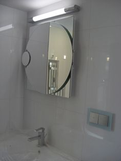 Italian #ValiAndVali fold out mirror - perfect for shaving and putting on make up. Includes a magnification mirror as well. In one of the two large bathrooms in the holiday apartment in Liepaja. Designed by Judith Abraham #HolidayRental www.theluxpod.com