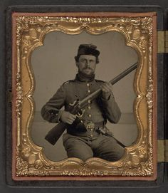 [Unidentified soldier in Union uniform with musket and bayonet] (LOC)---I believe this is a Confederate, the uniform resembles other confederate issue, the belt and buckle are the argument.
