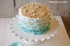 Mermaid birthday cake - blue ombre ruffle cake with sand and pearls on top