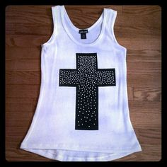Cross Tank Top Love this top! Just don't wear it as much as I should. In great condition. Size xs. Wet Seal Tops Tank Tops