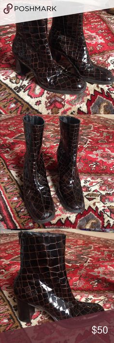 Nine West Snakeskin boots Dark brown shiny snakeskin boots. I am in love with these shoes but they just squeeze my feet too much because they are too small for me. Extremely sexy and fashionable! Authentic Nine West boots. They have been worn some so they aren't in brand new condition but they are still in great condition. Heels are about 2-3 inches and are comfortable on the arch and ankle. Nine West Shoes Ankle Boots & Booties