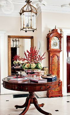 Foyer and fabulous chinoiserie grandfathers clock.