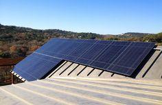 LS Residence - Austin Texas - contemporary - exterior - Blue Horse Building & Design - LUMOS LSX 200 Series - 200 watt frameless solar array equipped with Lightgauge Data Monitoring System by Lighthouse Solar  www.bluehorsebuilding.com