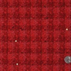 This is a medium weight wool blend with a woven plaid, metallic red threads, and applied sequins.