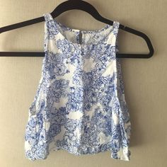 American Apparel Cropped Tank Floral detailed tank top. Opened back (so you can show off bralette underneath!) Fab to pair with high waisted jeans. Second picture shows pattern close up. NOT SOLD IN STORE ANYMORE American Apparel Tops Crop Tops