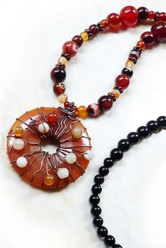 Cool Bohemian Necklace! Super smooth onyx and agate beads are carefully matched and gradated. The beautiful strand ends in a boho chic wire wrapped pendant with oxidized copper jewelry wire and more gemstone beads.